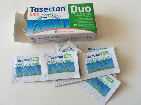 otevřené balení spolu se sáčky léku Tasectan Duo pro dětí leží na stole